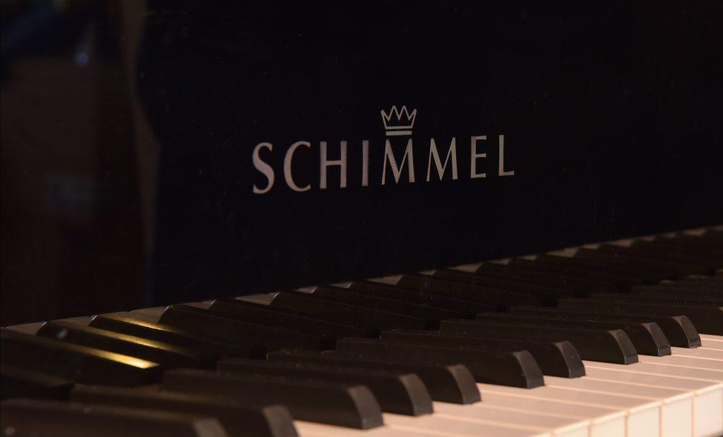 Logo shot of a Boudoir Schimmel piano at 8 Lambourn Road